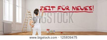 Painter writing German slogan