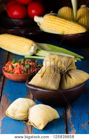 Latin American food. Traditional homemade humitas of corn and leaves