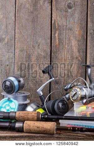 Fishing Tackles On Vertical Wooden Board Background