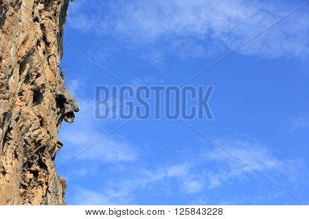 beautiful landscape with seaside rock under blue sky