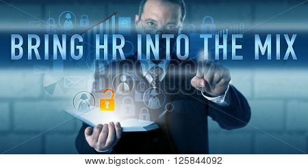 IT director is touching BRING HR INTO THE MIX on a translucent interactive display. Information technology concept and business function metaphor for involving HR departments in cybersecurity tasks.