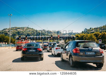 Nice, France - June 28, 2015: Cars passing through the point of toll highway, toll station
