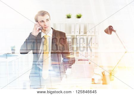 Businessman speaking on phone office at background. Double exposure. Concept of work.
