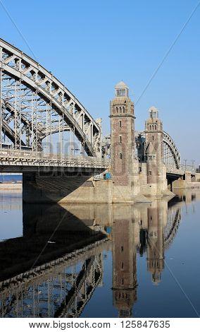 Bridge Peter Great reflected in water in St. Petersburg