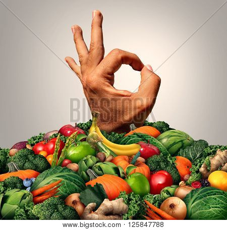 Delicious healthy food concept as a chef hand emerging out of a mountain of green fruit vegetables nuts and berries as a nutrition metaphor for savory fresh market produce.