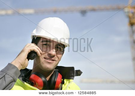Portrait of a young worker with walkie-talkie