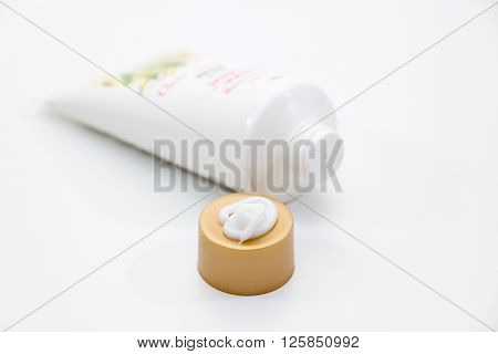 tube with a small amount of the squeezed out white cream