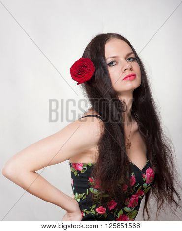 Girl with rose her hair