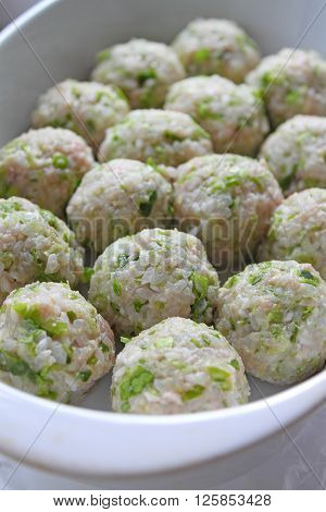 cooking meat balls of rice and meat
