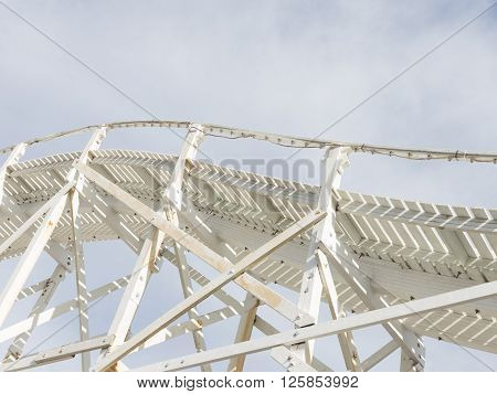 beautiful abstraction of a white wooden structure of the old road leaving the sky with white cumulus and cirrus clouds