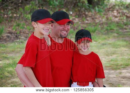 Outdoor portrait of cute father and his sons