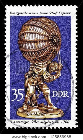 GERMAN DEMOCRATIC REPUBLIC - CIRCA 1976 : Cancelled postage stamp printed by German Democratic Republic, that shows Load bearer.