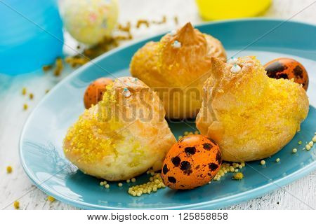 Easter dessert in the shape of a bird. Traditional easter baking composition selective focus