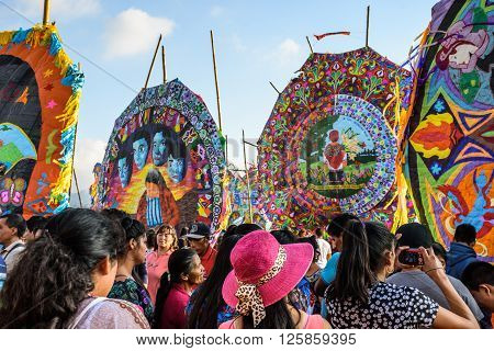 Sumpango, Guatemala - November 1 2015: Visitors at giant kite festival on All Saints' Day to honor spirits of dead.