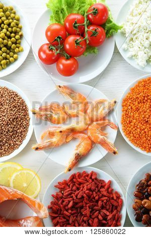Diet food on a light wooden background