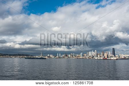 Billowing clouds hover over the Seattle skyline.