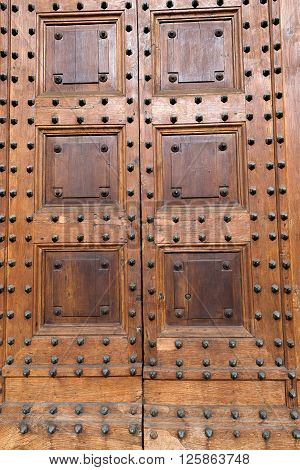 Detail of an ancient wooden door with metallic studs. Pistoia Cathedral Tuscany Italy