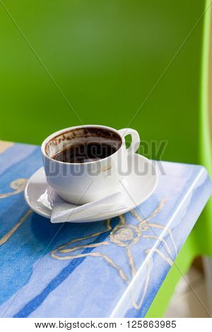 Cofee cup on a table vertical image