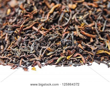 Background of dry black unpressed tea with flavors