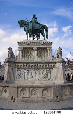 Majestic monument to King of Hungary. High pedestal  with two lions and scenes from life of King. King sits proudly on horseback.