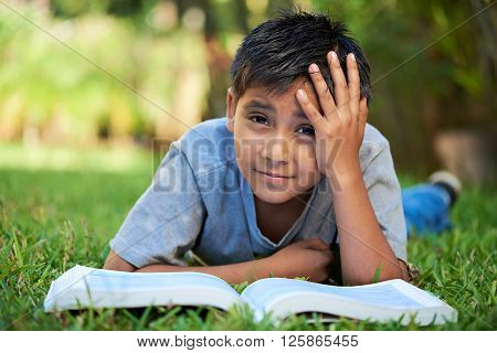 Boy Bored With Book