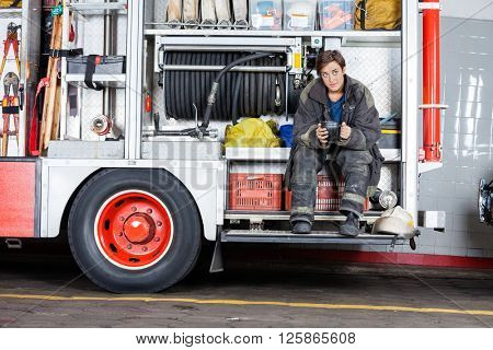 Thoughtful Firewoman Sitting In Truck