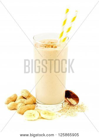 Peanut Butter Banana Oat Smoothie In A Glass With Straws And Scattered Ingredients Over A White Back