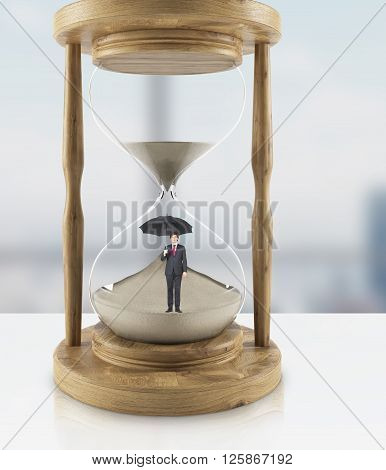 Businessman with umbrella in hourglass. 3D Rendering