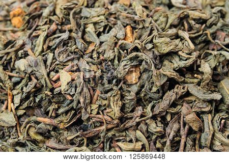 Background of dry green unpressed tea with flavors
