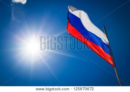 Russian flag on blue sky background