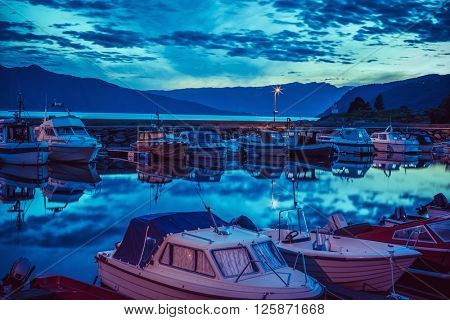 Boats in dock. Twilight landscape with soft blue tint.
