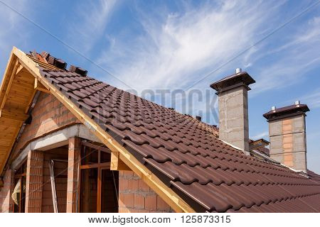 New red tiled Roof with chimneys and skylight