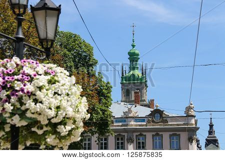 Lviv Ukraine - July 5 2014: Streets in the Old Town. View to Korniakt tower. Lviv historic city center is on the UNESCO World Heritage List