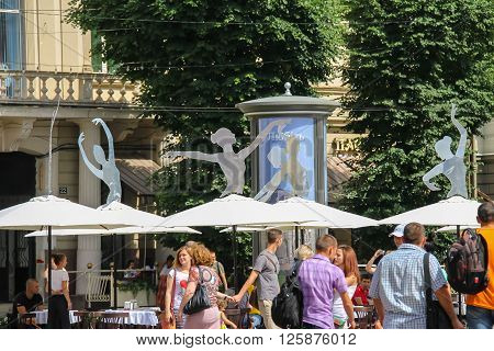 Lviv Ukraine - July 5 2014: Tourists near the building of Opera and Ballet Theatre in historic city center