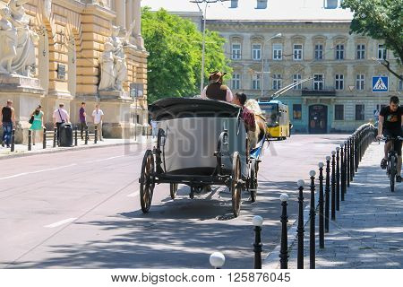 Lviv Ukraine - July 5 2014: Tourist carriage with people on the streets in historical city center