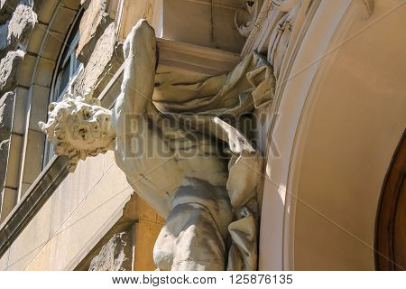 Part of old house with atlas on side of the entrance in historical city center. Lviv Ukraine