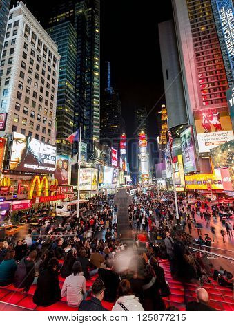 NEW YORK CITY, USA - Nov 13, 2011: Crowds of tourist enjoy the nighttime view and colorful signage in Times Square in New York City.