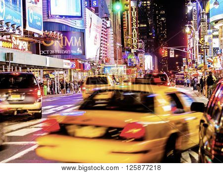NEW YORK CITY, USA - Nov 13, 2011: Yellow cabs and traffic with colorful signage in Times Square and 42nd Street in New York City.