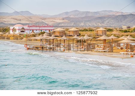 MARSA ALAM, EGYPT, MARCH 28, 2016:  Three Corners Equinox Beach Hotel at Red Sea shore - long beach with umbrellas