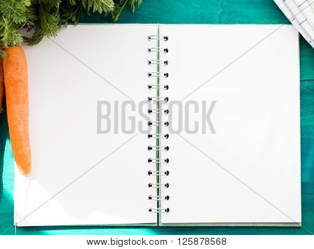 Open Note Book With Blank Pages On Green Table