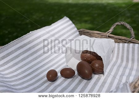 Chocolate Eggs On Table Cloth In Nature