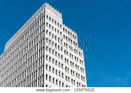 Modern skyscraper in front of a blue sky seen in Berlin, Germany