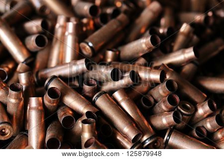 bullet, casings from bullets, the background for the news, the concept of illicit arms trafficking