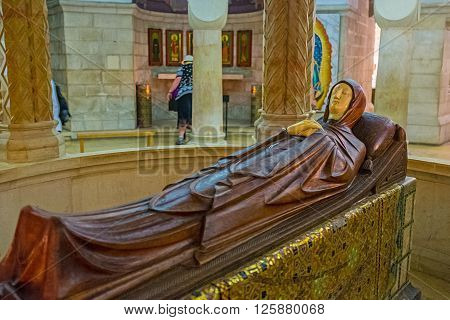 JERUSALEM ISRAEL - FEBRUARY 16 2016: The wooden statue of the Dormition of Virgin Mary in the center of the crypt in Dormition Church on February 16 in Jerusalem.