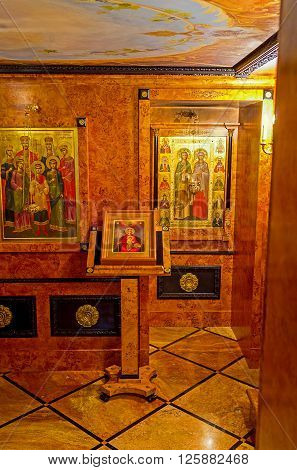 JERUSALEM ISRAEL - FEBRUARY 16 2016: The small Chapel in Alexander Nevsky Church lined with valuable tree species on February 16 in Jerusalem.
