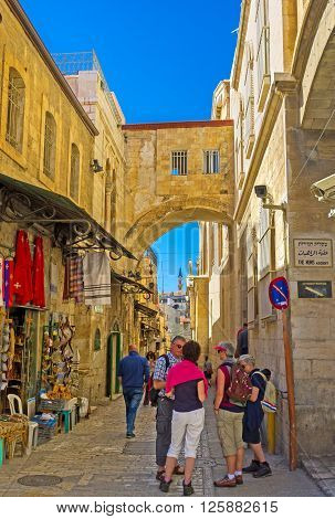 JERUSALEM ISRAEL - FEBRUARY 16 2016: The way of Jesus Christ to Calvary named Via Dolorosa is the crowded place full of pilgrims tourists and locals on February 16 in Jerusalem.