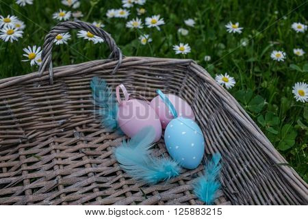 Three Painted Eggs With Feathering In Basket