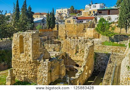 The walled town of Jerusalem stores the ruins of the Roman and Byzantine period at the archaeological site of Bethesda Pool Israel.