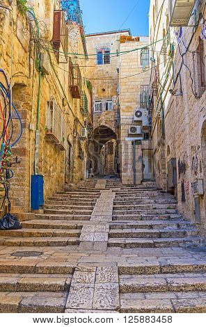 JERUSALEM, ISRAEL - FEBRUARY 18, 2016: The old Jerusalem located on the hilly area so there are a lot of streets with long stairs, on February 18 in Jerusalem.