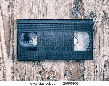 video cassette close-up on a wooden surface retro-style old record sound and images